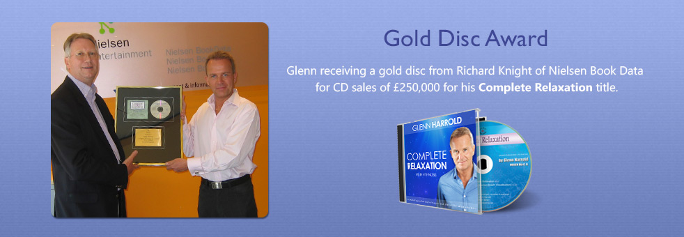Glenn receiving a gold disc award for Complete Relaxation from Nielsen BookData